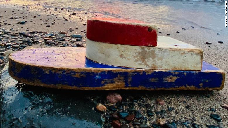 A tiny boat was discovered on a remote beach 27 years after it was launched by teachers