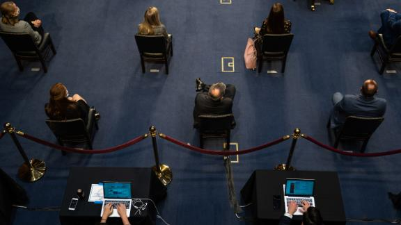 People practice social distancing during the hearing on October 14.