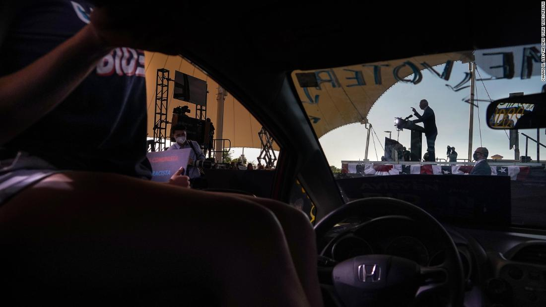 Biden is seen through the windshield of a car while speaking at a campaign event in Miramar, Florida, on October 13.