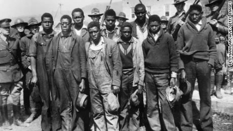 Clarence Norris, Alain Montgomery, Andy Wright, Willie Roberson, Ozzy Powell, Eugene Williams, Charlie Weims, Roy Wright and Haywood Patterson were arrested in 1931 in Alabama.