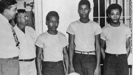 Lake County Sheriff Willis McCall, far left, and an unidentified man stand in Florida with Walter Irvin, Samuel Shepherd, and Charles Greenlee from left.  The three men and a fourth were charged with rape in 1949.