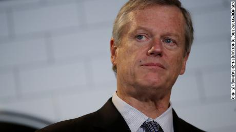Gov. Charlie Baker takes questions from the media at Mill City BBQ and Brew last month.