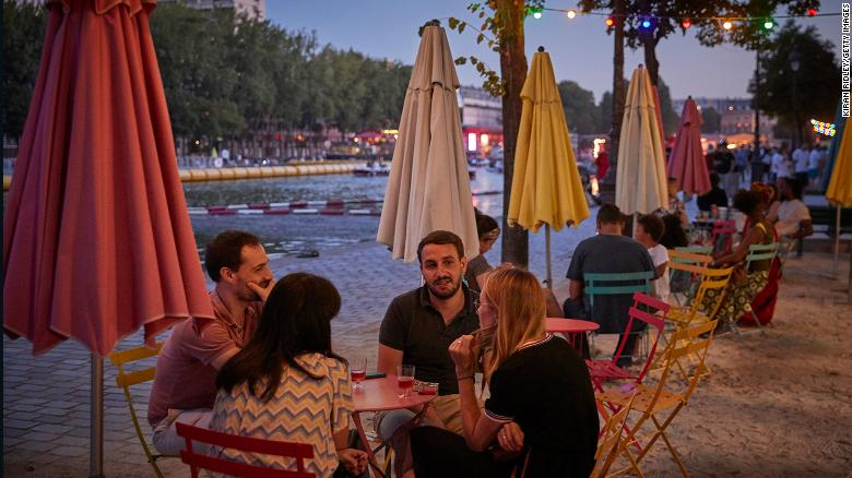 Parisians enjoy a socially distanced opening night of Paris Plages at La Villette on July 18. The city and several others will now face a 9 p.m. to 6 a.m. curfew.