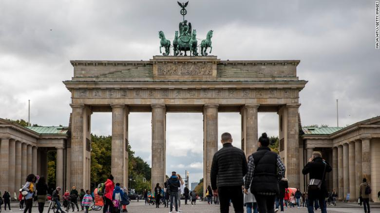 Tourists walk at the Brandenburg Gate in Berlin, Germany on October 12, as gatherings were limited to 10 people and an 11 p.m. curfew imposed in several regions.