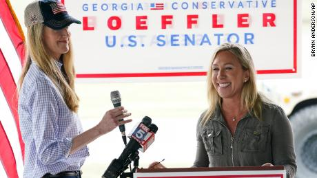 Republican congressional candidate Marjorie Taylor Greene on the right introduces Senator Kelly Loeffler during a news conference Thursday in Dallas, Georgia.