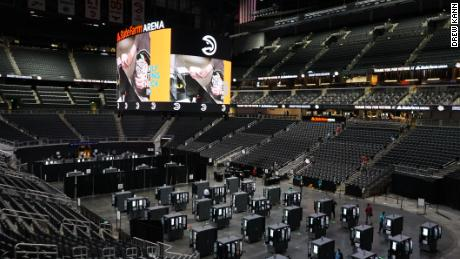 Voters cast their ballots inside of Atlanta's State Farm Arena, the largest early voting site in Georgia, on the first day of early voting on October 12, 2020.