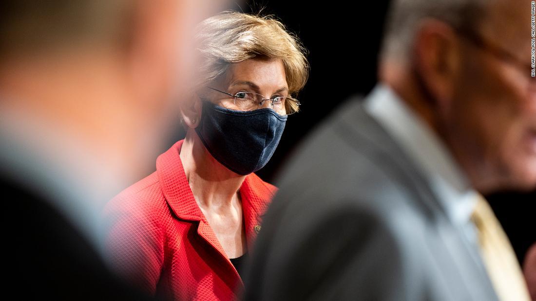 Elizabeth Warren demands investigation into elite investors accessing Trump briefings