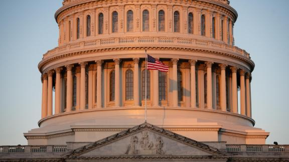 An American flag flies outside the US Capitol on October 15.