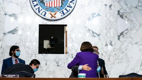US Sen. Lindsey Graham, the chairman of the Senate Judiciary Committe, hugs US Sen. Dianne Feinstein, the top Democrat on the committee, after the fourth day of Barrett's confirmation hearings.