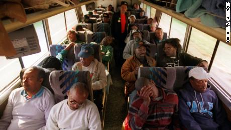 Black men from the Chicago area make their way toward Washington Sunday, Oct. 15, 1995, via bus to participate in the Million Man March Monday.