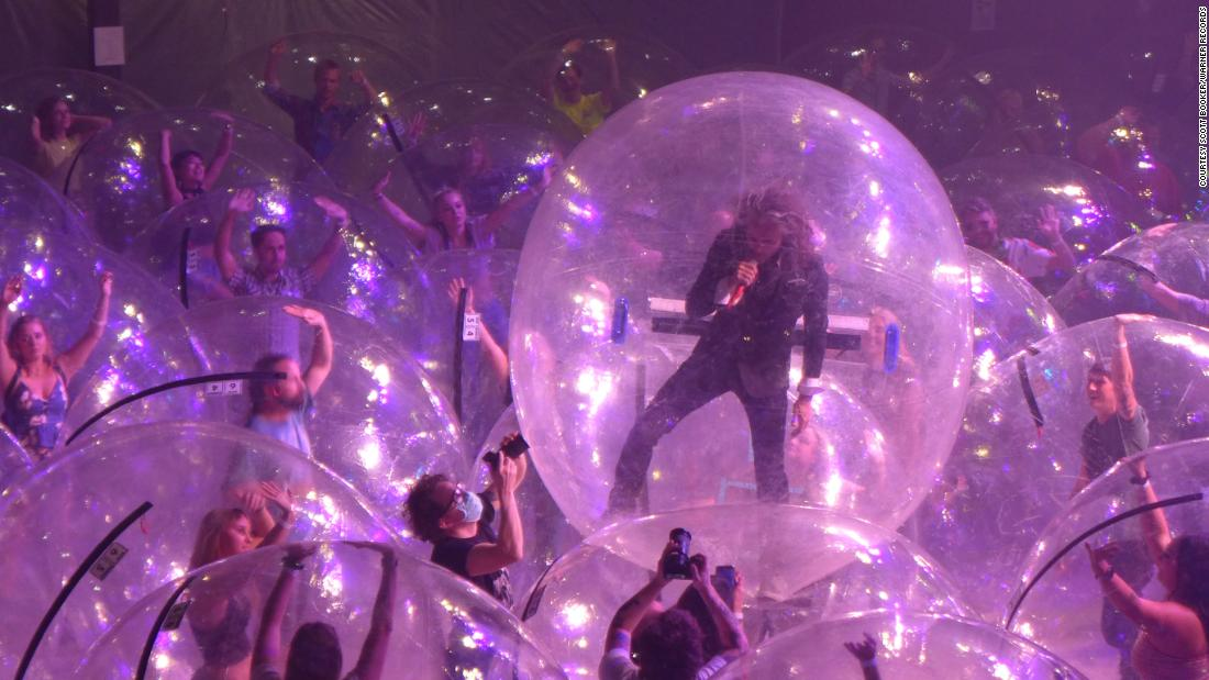 The Flaming Lips placed themselves — and all attending fans — inside individual plastic spheres to prevent the spread of Covid-19 while playing live.