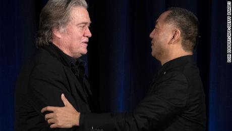 Former White House Chief Strategist Steve Bannon (L) greets fugitive Chinese billionaire Guo Wengui before introducing him at a news conference on November 20, 2018 in New York.