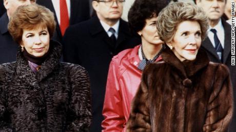 Raisa Gorbachev, wife of Mikhail Gorbachev, is accompanied by Nancy Reagan in December 1987.