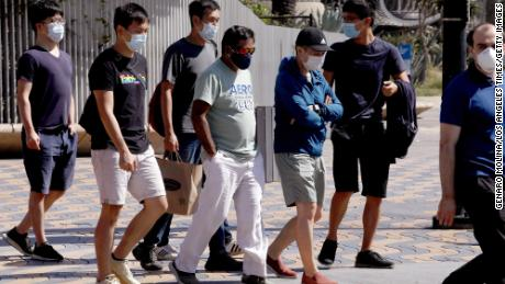 Pedestrians wear masks while visiting Santa Monica on September 29.