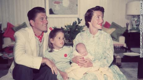 The Reagans with daughter Patti and infant son Ron Jr circa 1955.