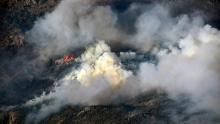 Heavy Smoke and flames rise from the Cameron Peak fire as the fire continues to burn in Larimer County.