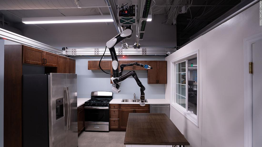"Toyota Research Institute (TRI) is developing human-assist robots in its labs in California. This ""gantry robot"" is adapted for the home from a style more often seen in assembly and manufacturing lines. Since these robots hang from the ceiling like a bat, they save floor space and can reach other machines and parts easily from above. This TRI robot is able to complete tasks such as loading the dishwasher."