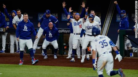 Cody Bellinger of the LA Dodgers celebrates with his teammates after hitting a home run in the seventh inning during Game 7 of the NLCS against the Atlanta Braves.