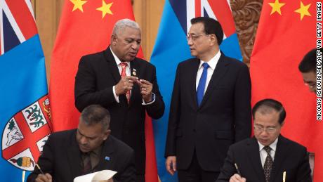 "Fiji's Prime Minister Josaia Voreqe ""Frank"" Bainimarama talks with Chinese Premier Li Keqiang during a signing ceremony at the Great Hall of the People in Beijing on May 16, 2017."