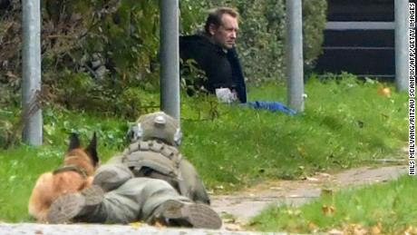 A police marksman and his dog observes Peter Madsen as he attempts to break out of prison in Albertslund, Denmark.