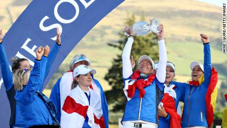 Suzann Pettersen of Team Europe lifts the trophy with her teammates after winning the Solheim Cup.