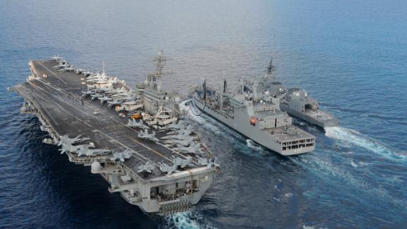 The aircraft carrier USS Theodore Roosevelt  and Japanese Maritime Self-Defense Force Akizuki-class destroyer JS Fuyuzuki sail alongside the Indian Deepak-class fleet tanker INS Shakti during Exercise Malabar 2015.