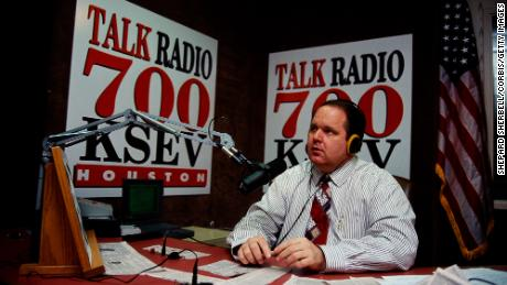 Rush Limbaugh sits at his desk at Talk Radio 700 KSEV during the Republican National Convention in Houston. (Photo by Shepard Sherbell/Corbis/Getty Images)