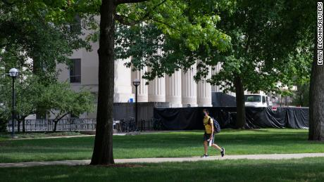 A student walks through the Diag on the University of Michigan campus in August. All Michigan undergraduates are now under a two-week emergency stay-at-home order.