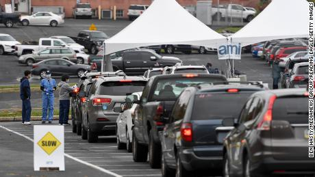 People in cars wait in line for Covid-19 testing in Reading, Pennsylvania, on Tuesday morning, October 13.