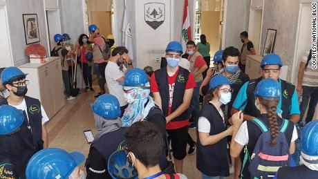 Activists gather at National Bloc headquarters, which was damaged during a deadly August 4 blast in Beirut, for a large clean-up campaign in the wake of the explosion.
