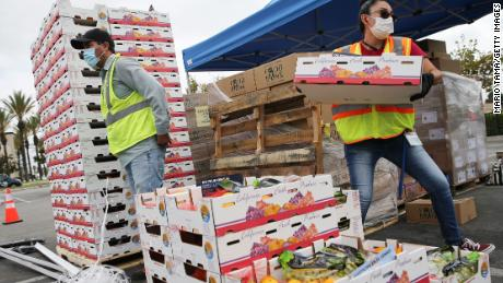 Boxes of food are prepared to be distributed by the Los Angeles Regional Food Bank to people facing economic or food insecurity amid the COVID-19 pandemic on August 6, 2020 in Paramount, California.