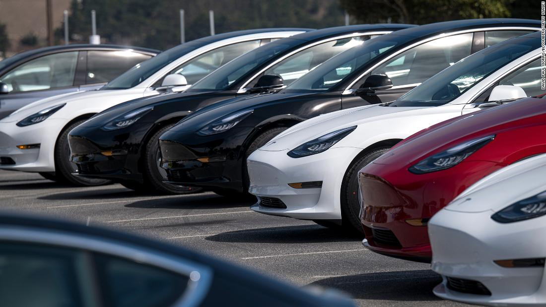 Tesla posts record profit and maintains ambitious sales target
