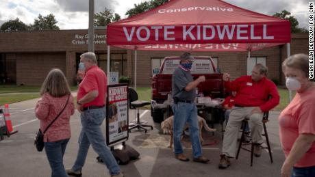 Rep. Keith Kidwell greets voters near an early voting site in Washington, North Carolina.