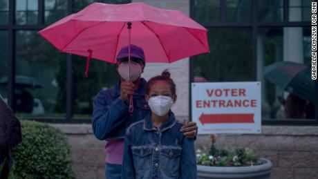 Biden supporter Bridgette Hodges and her 8-year-old grandchild Sanaa waited in an early voting line for over two hours.