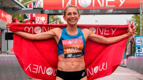 Hall celebrates her performance at the London Marathon finish line.