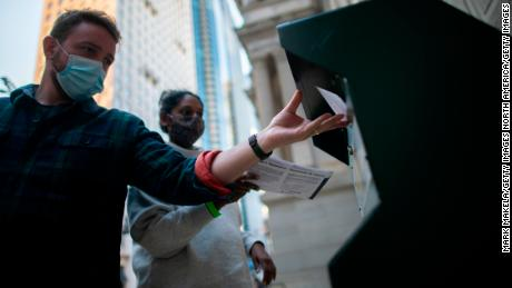 PHILADELPHIA, PA - OCTOBER 17:  Voters cast their early voting ballot at drop box outside of City Hall on October 17, 2020 in Philadelphia, Pennsylvania.  With the election only a little more than two weeks away, a new form of in-person early voting by using mail ballots, has enabled millions of voters to already cast their ballots.  President Donald Trump won the battleground state of Pennsylvania by only 44,000 votes in 2016, the first Republican to do so since President George Bush in 1988.  (Photo by Mark Makela/Getty Images)