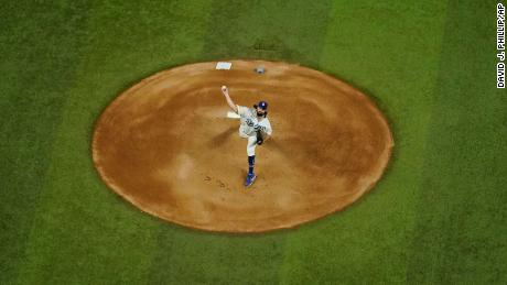 Los Angeles Dodgers starting pitcher Tony Gonsolin throws against the Tampa Bay Rays during the first inning in Game 2 of the baseball World Series Wednesday, Oct. 21, 2020, in Arlington, Texas. (AP Photo/David J. Phillip)