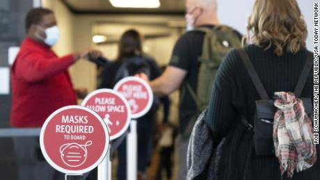 Passengers prepare to board a plane at the Sky Harbor International Airport in Phoenix, Arizona on October 13, 2020