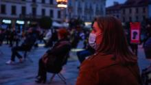 A woman wears a mask during a socially-distanced concert to celebrate the 100th anniversary of the birth of former Pope John Paul II, in Wadowice, Poland on October 18.