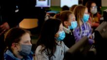 High school students wear face masks as they take part in an electronic learning session in Frankfurt, Germany, on  Wednesday.