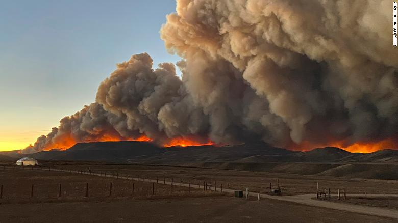 Colorado officials are warning that two major wildfires could merge