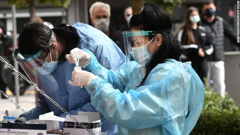 A health worker checks a coronavirus test in Kozani, Greece, on October 16, 2020.