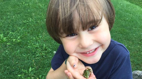 Noah's mom says he loves to go out and find frogs in the back yard. He makes a place with water and rocks for them to hang out in, observes them and then releases them near the river that runs behind the house so that they are safe from the lawn mower when his dad cuts the grass.