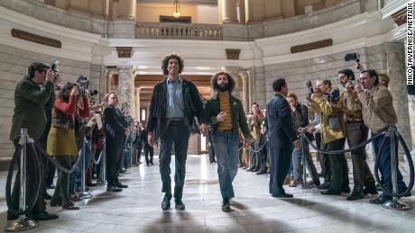 "Sacha Baron Cohen as Abbie Hoffman and Jeremy Strong as Jerry Rubin in ""The Trial of the Chicago 7."""