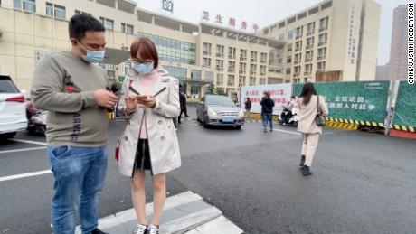 Guangdong resident Ani Ku is in front of a hospital in the eastern Chinese city of Yiwu, where she is trying to get an experimental coronavirus vaccine.