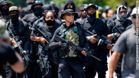 LOUISVILLE, KY - JULY 25:  Grandmaster Jay (C) leader of NFAC leads a march of his group and supporters on July 25, 2020 in Louisville, Kentucky. The group is marching in response to the killing of Breonna Taylor. (Photo by Brett Carlsen/Getty Images)