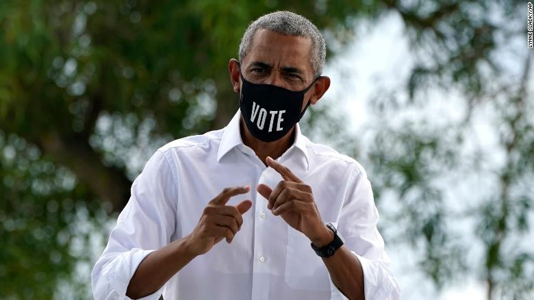 Former President Barack Obama walks on stage as he campaigns for Democratic presidential candidate former Vice President Joe Biden at Florida International University, Saturday, Oct. 24, 2020, in North Miami, Fla.