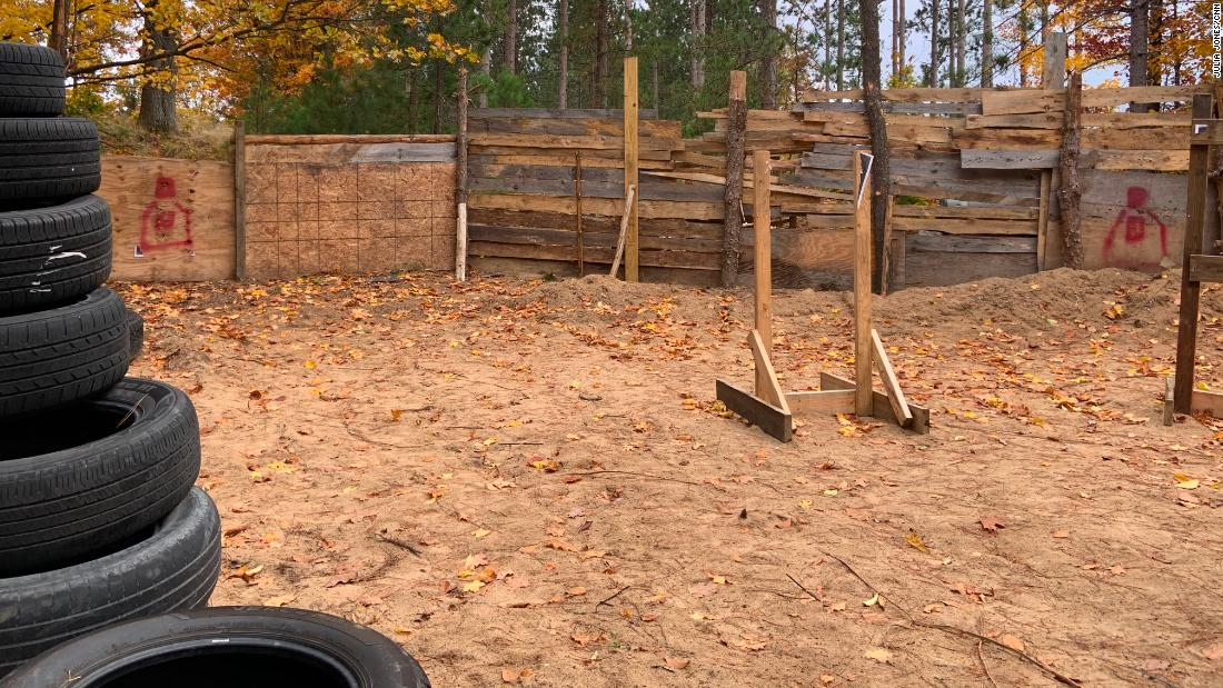 Tires are piled up on the property in Luther where Ty Garbin and others are accused of holding training exercises.