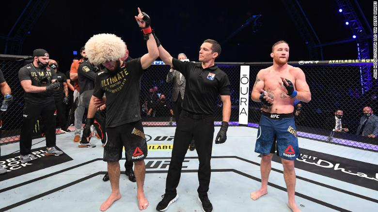Khabib Nurmagomedov of Russia, left, celebrates his victory over Justin Gaethje in their lightweight title bout on Saturday, October 25, on UFC Fight Island, Abu Dhabi, United Arab Emirates.