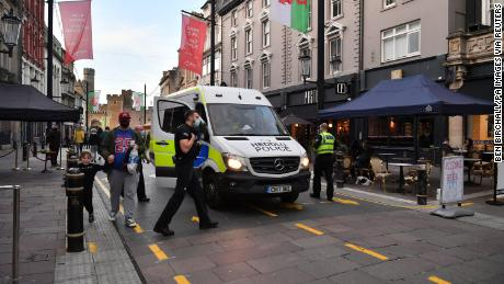 Police officers patrol the center of Cardiff before Wales enter the lockdown for the second time.
